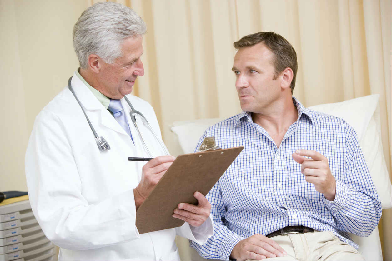 man speaking with his doctor