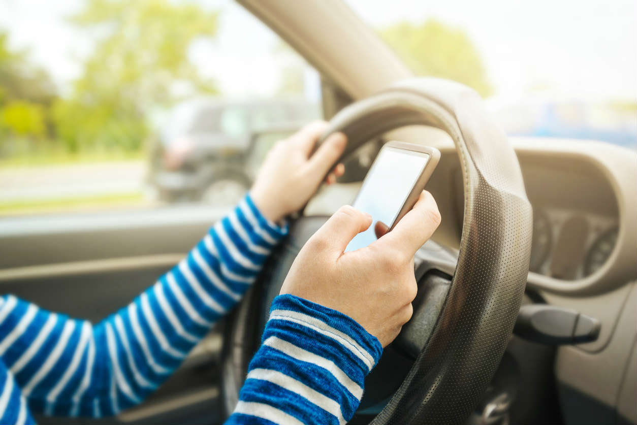 St. Louis woman texting and driving