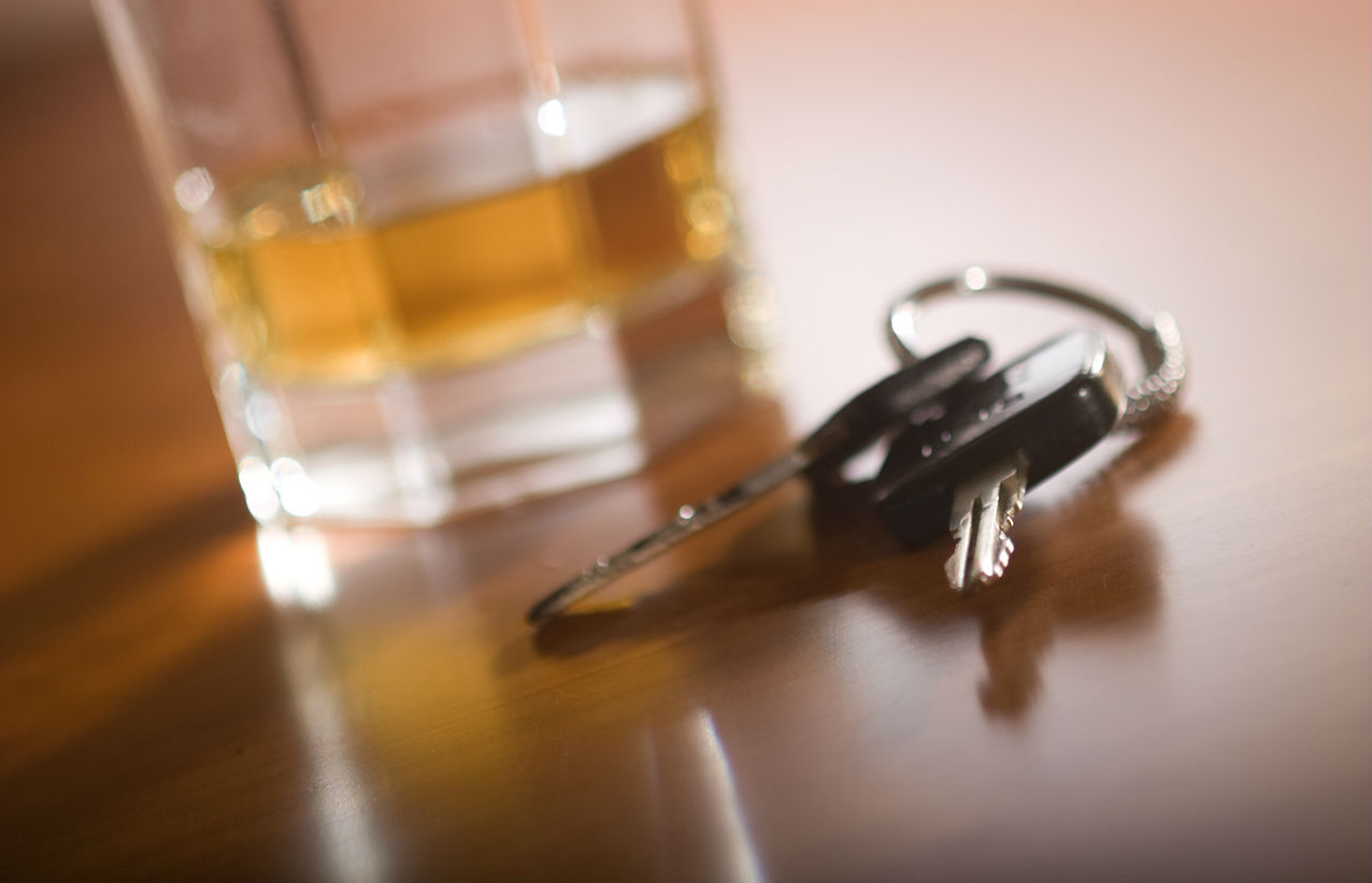 alcoholic drink next to car keys
