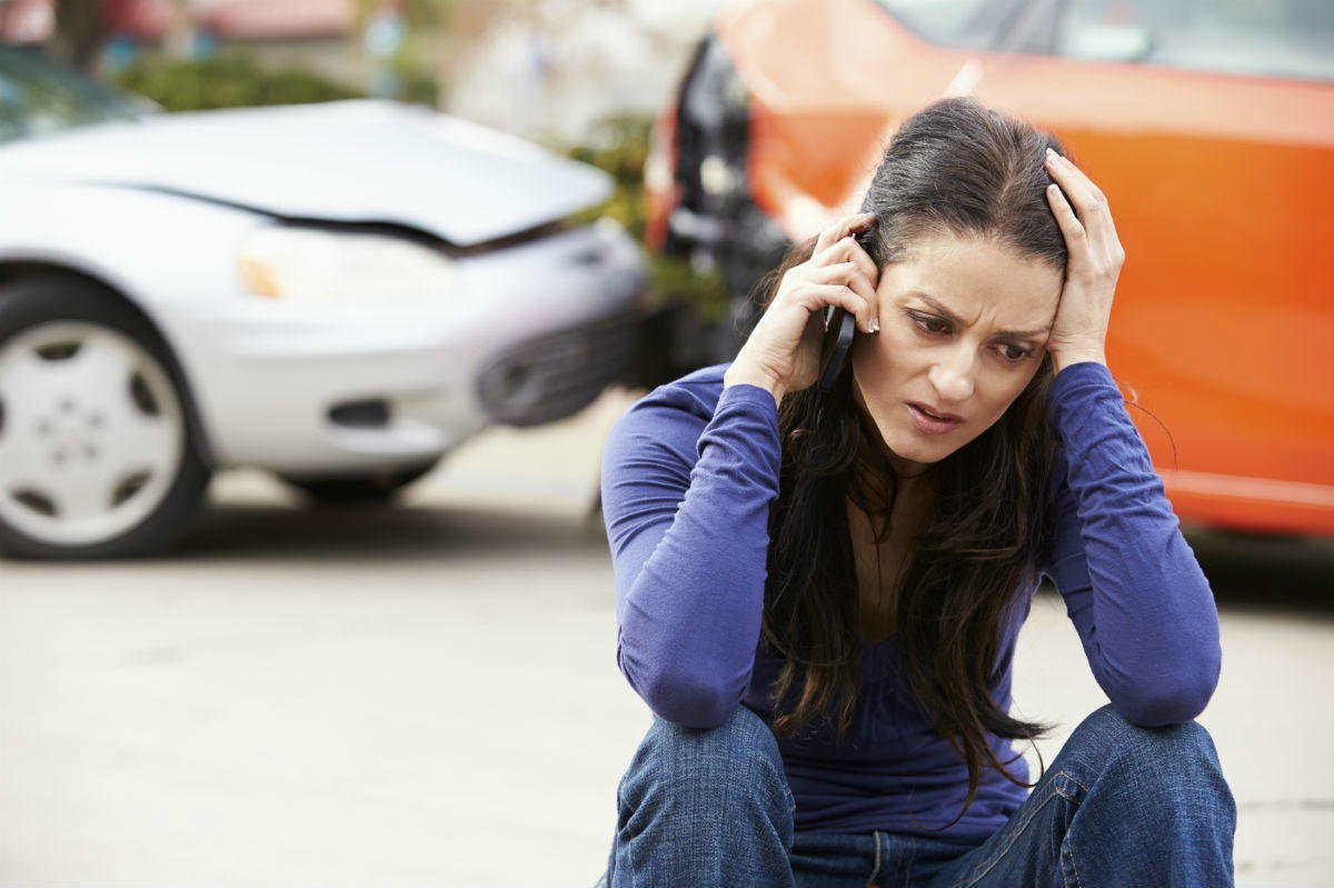 woman on the phone with car accident lawyer