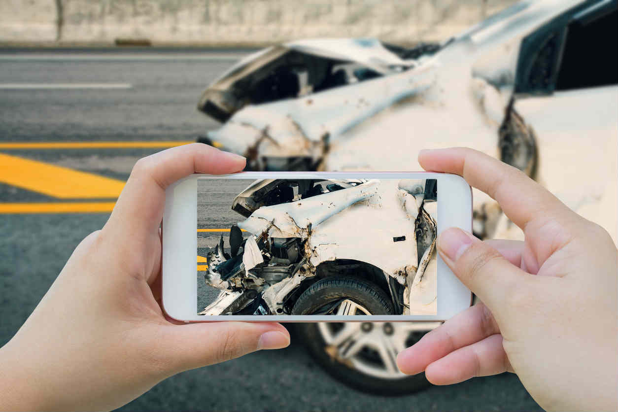 taking a photo after a car accident