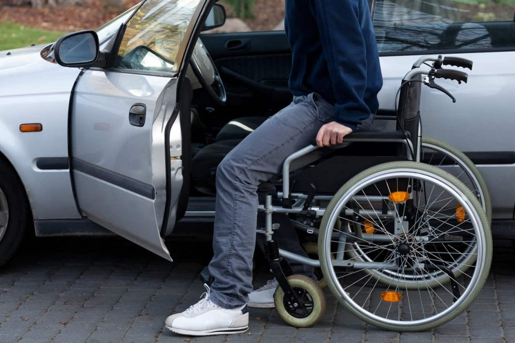 disabled driver getting in car