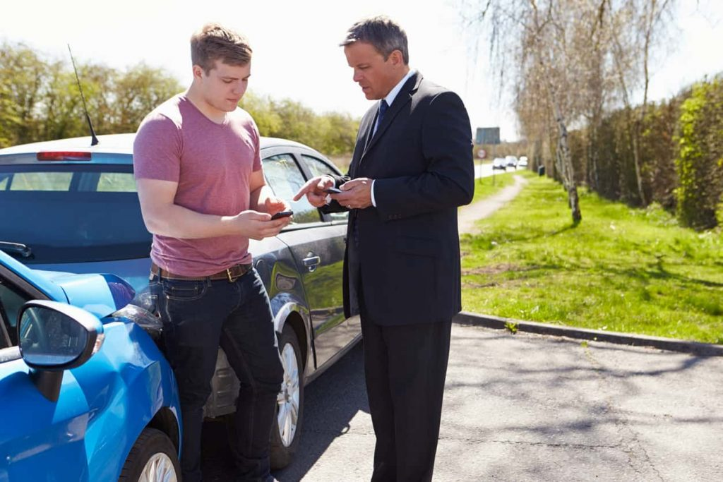 two st. louis men exchanging insurance information after car accident