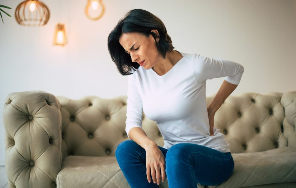 woman with lower back pain after car accident