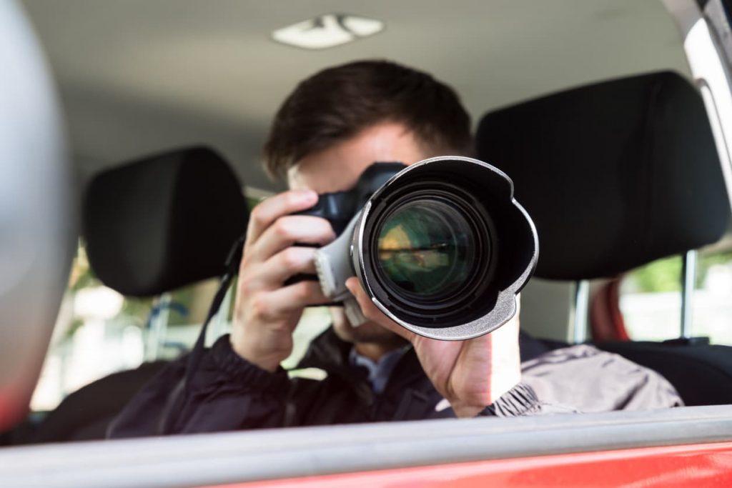 private investigator taking a picture