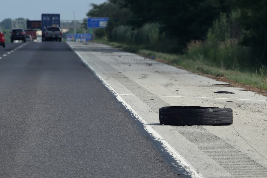 tire on the side of the highway